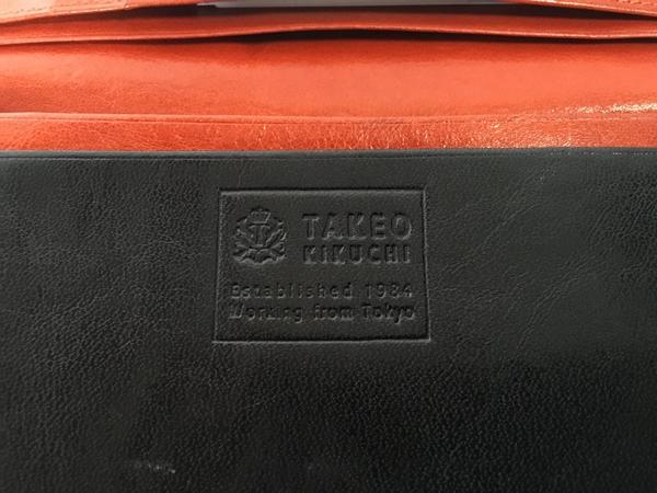タケオキクチのロゴ