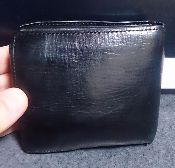 コンプリートワークスの二つ折り財布